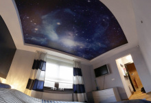 Bedroom with printed ceiling