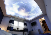 Printed sky ceiling in bedroom