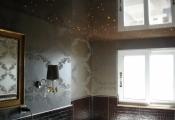 Installed stretch ceiling in bathroom