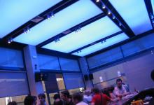 Luminous ceiling panels in restaurant