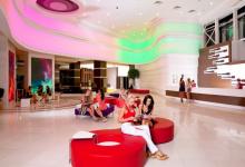 Wavy luminous ceiling in shopping mall