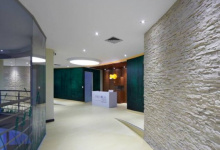 Hallway with suspended ceiling