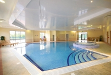Swimming pools with suspended ceilings