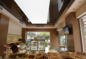 Retail shop with luminous ceiling